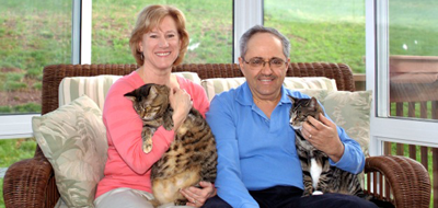 Patty Kline Capaldo with her husband and their two cats